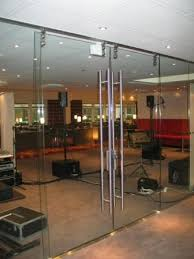 frameless glass doors that create open feel to your room