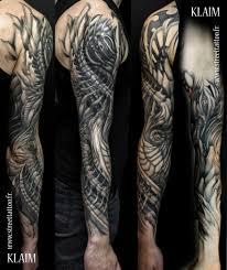 фото тату в стиле биомеханика от мастера Klaim