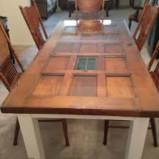 our new dining room table made from an old door built in 1947 we love it