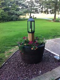 Wonder if I can do this in my backyard for more lighting with the new  playground Whiskey barrel planter with lantern.