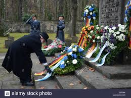 Of Wreaths Rabbi Chaim Rozwaski Stands In Front Of Wreaths Laid Down At The