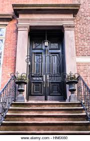 city apartment building entrance. typical entrance door to a new york city apartment building residential home - stock photo t