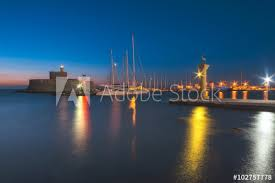 Fortress of St. Nicholas and sculpture Rhodes deer and deer at dawn. Rhodes  Island. Greece - Buy this stock photo and explore similar images at Adobe  Stock | Adobe Stock