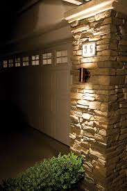 exterior wall stone cladding house design with outdoor led wall mounted sconce lighting ideas