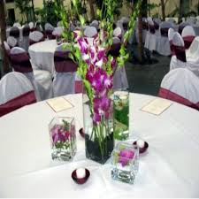 ... center of the table. These decorative vases could contain a singular  flower or a bunch of flowers. Roses, camellias, lilies are great wedding  flowers.
