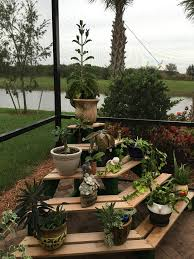 DIY 4 tiered wooden outdoor plant stand display.
