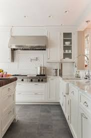 white cabinets dark tile floors. Unique Floors Creamy White Cabinets Paired With Supreme White Quartzite Countertops   Venegas And Company Kitchen Pinterest Kitchen Flooring Flooring Inside Cabinets Dark Tile Floors K