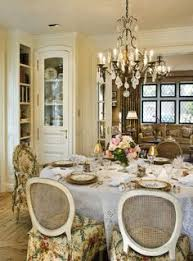 dining room slipcover fabric pulls colors from formal living room across whitewash french country dining room furniture to lighten and brighten