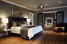 dark wood floor bedroom. example of a trendy master dark wood floor bedroom design in seattle with gray walls