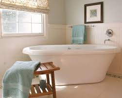 Bathroom With Freestanding Tub And White Beadboard Wainscoting ...