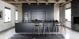 Not quite as stark as a white kitchen or as bold as a black one, these gray  kitchens softly lend a sophisticated air to the home.