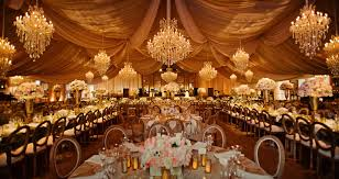 tent walls in gold washed the d panels in the tent ceiling in gold washed the acrylic beaded chandelier in gold pin spotted the guest tables
