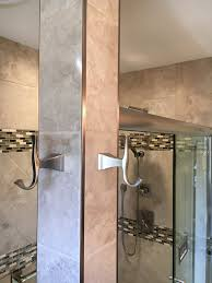 stainless steel bathroom accents with metal schluter strips to edge out tile tan tile