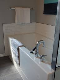 cleaning bathroom tile and tubs sprinkle baking soda in place