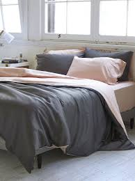 rest easy with this reversible soft pink and grey duvet set made with 100