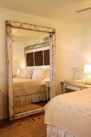Beautiful elegant, but on the tiny bit of a rustic edge to the gorgeous  antique style Big mirror, It looks great were it's placed ovelooking the  entire side ...