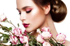 portrait of young beautiful woman with stylish make up and colorful roses around her face