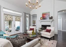 coast furniture and interiors. Modern Sofa With Vibrant Custom Throw Pillows. Cream Colored Accent Chairs In Front Of A Coast Furniture And Interiors O