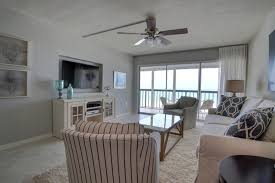 Amazing Vintage Florida Beach Condo Gets A Transitional Remodel Beach Style  Living Room