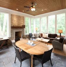 four seasons furniture reviews with traditional porch also brown sofa ceiling fan fireplace floating mantel gray tile floor natural lighting outdoor space
