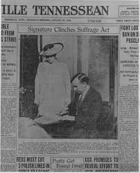 front page of tennessean suffrage act war of the roses women  newspaper print showing governor a h roberts signing papers certifying tennessee s passage of the 19th amendment governor roberts is shown seated while