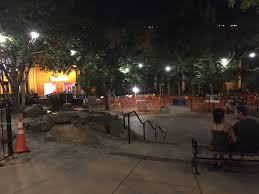 strands of construction lights have been placed in pritchard park trees to keep it illuminated until