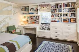 a child s bedroom with dark hardwood floors custom built cream chest of drawers study desk and open shelves