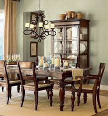 sage green wall color with antique wrought iron chandelier for french inspired dining room ideas wooden hutch decor master bedroom chandeliers modern table