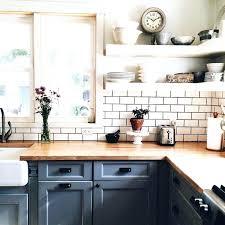 open shelves lower cabinets painted blue butcher block counters subway tile kitchen backsplash what size white