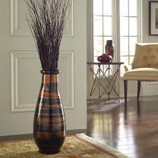 large floor vase arrangement designed by sandra macphersontall