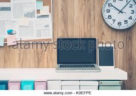 office pinboard. laptop and folders on a shelf in the office pinboard background business