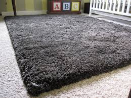 charming black rugs for floor decor ideas clean rug yellow wool soft crate and