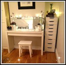 plentiful off white finished hardwood ikea vanity with lights as well as small square stool on wood floors also tall dresser as white bedroom decors
