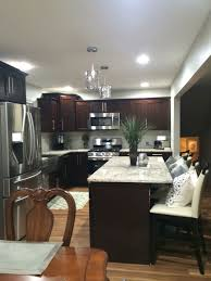 cabinet and lighting. light granite counters shaker cocoa cabinets and lighter wood floor cabinet lighting
