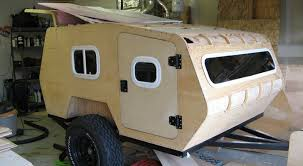 Diy travel trailer Remodel Installing Pink Insulation Panels Between Wall Layers Practically Hitched Diy Off Road Teardrop Camper Made For Rough Terrain