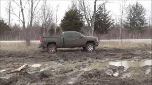 ford trucks mudding. red ford mud mudders lifted chevy pickup truck mudding s after snow trucks