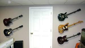 wall guitar hanger wall guitar hangers sumptuous design how to hang a guitar on the wall wall guitar hanger