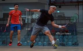 Ex-junior player's love for squash not quashed