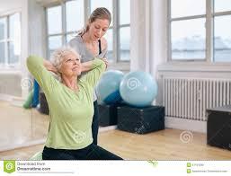 Light Pilates Yoga Studio Trainer Helping Senior Woman Exercising Stock Image Image