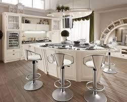 swivel counter stools backless white modern crystal chandelier plain wooden table colorful fl pattern tile backsplash whitewashed brick wall gemini