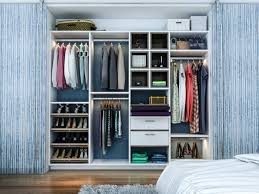 reach in closet system with slanted shoe shelves hanging rods and drawers