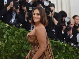 celebrities on body hair ashley graham in brown sequinned dress while photographers snap photos from