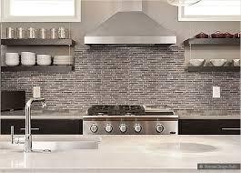 modern brown kitchen cabinet glass mosaic backsplash tile white countertop