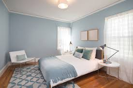 if you are looking to make an eye catching statement pick a single color and use it throughout the bedroom the shade in this space is an icy blue and is