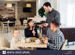 restaurant waiter taking order. Fine Restaurant Friendly Smiling Waiter Taking Order At Table Of Family Having Dinner  Together  Stock Image Intended Restaurant Waiter Taking Order I
