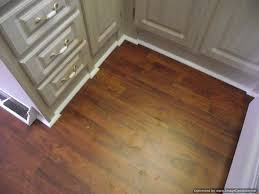allen roth laminate flooring being installed in a small kitchen 10mm from