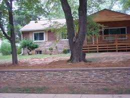 matching the stones of ray s new retaining wall to the look of his exterior home design