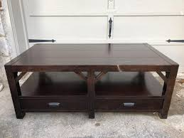 We could not get good pictures of this. Gleaton S Metro Atlanta Auction Company Estate Sale Business Marketplace Auction Jewelry Baseball Cards Appliances And More Item Thomasville Wanderlust Coffee Table With Double Side Drawers