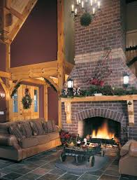 red brick construction and rustic wooden mantels are always a popular choice for post and beam home fireplaces and they provide a uniform