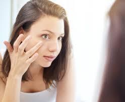 woman touching under her eye